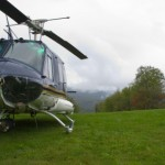 Helicopter on grass with scenic view