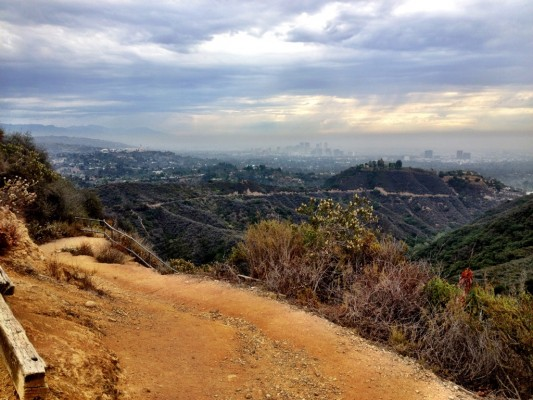 Backbone Trail in the foreground, downtown Los Angeles skyline in the background.