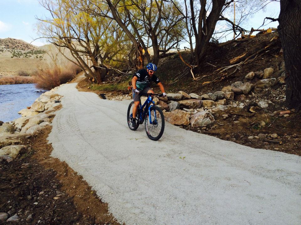 Rolling along the new riverside path. Photo: Shawn Gillis.