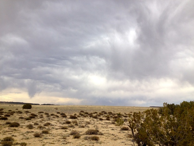 As I rode, the wind picked up, and clouds began to roll down off the mountains and into the plains.