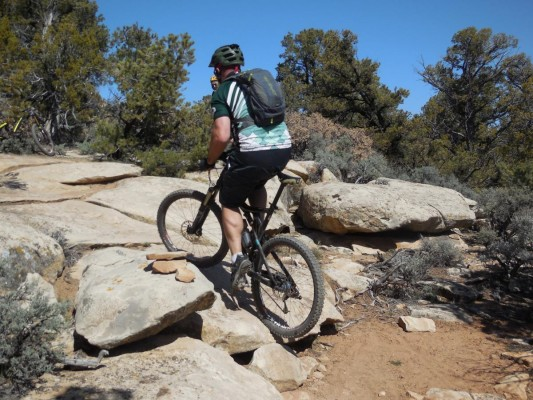 The author hits one of many step ups early in the Little Creek Mesa ride.