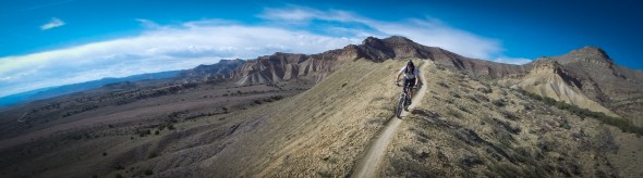 Notice that the trail serves as a line to draw the viewer toward the subject, the rider, and not the otherwise extraordinary background. Rider: Grant L. GoPro helmet mount