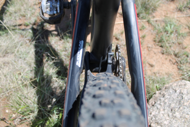 "This photo shows ample clearance for wider tires. Even the seatstays have been formed with indents to accommodate the side knobs should you wish to step up to a 2.4""."