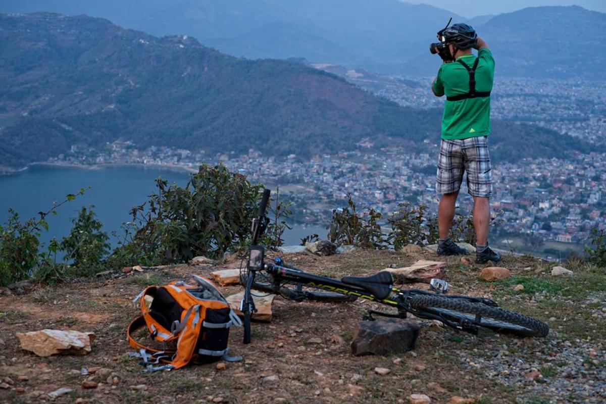 """MTB in Pokhara, view on Phewa Lake from around world peace pagoda in Pokhara, Nepal."""