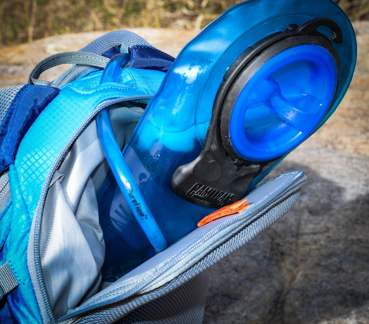 This is a 100oz Camelbak reservoir with about 65oz in it that I was able to squeeze in the pack with a little room to spare.