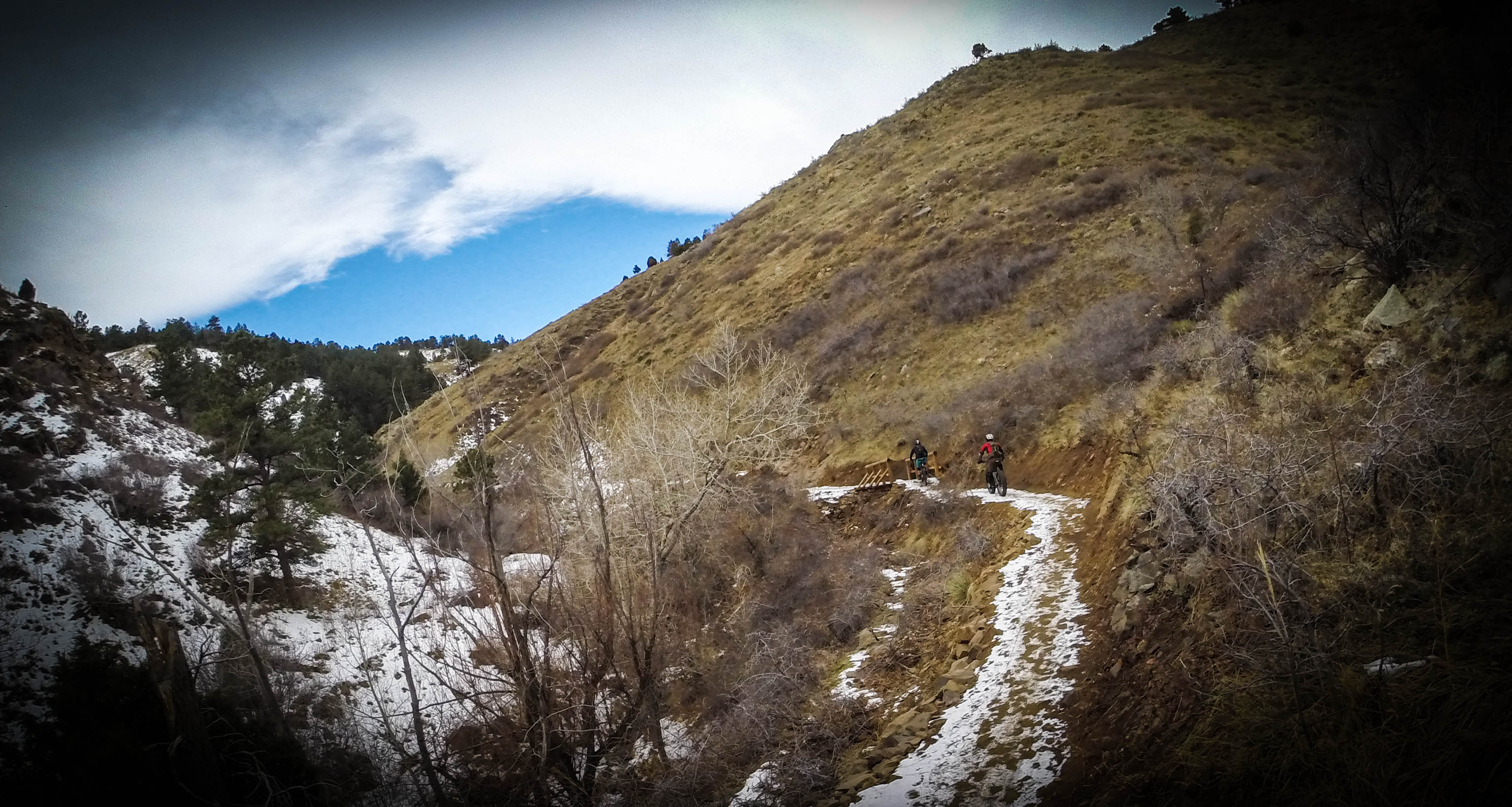 Climbing up the snow littered singletrack of Lower Apex
