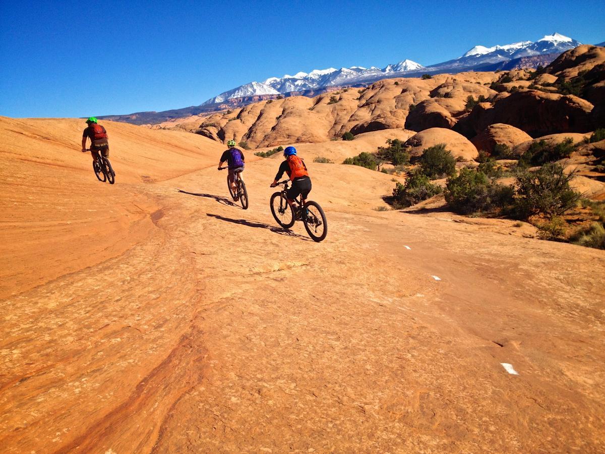 """Snow on the La Sals, sun on Slickrock."" Moab, Utah. Photo: Erik Proano."