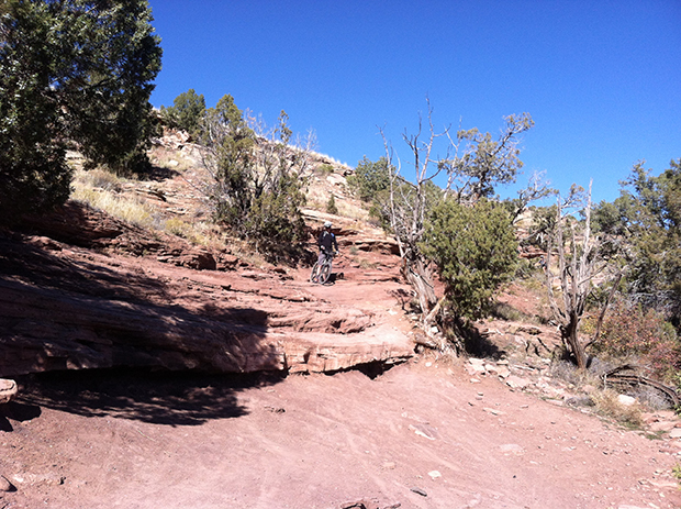 Looking for the line on a big drop on Fruita's Horsethief Bench trail