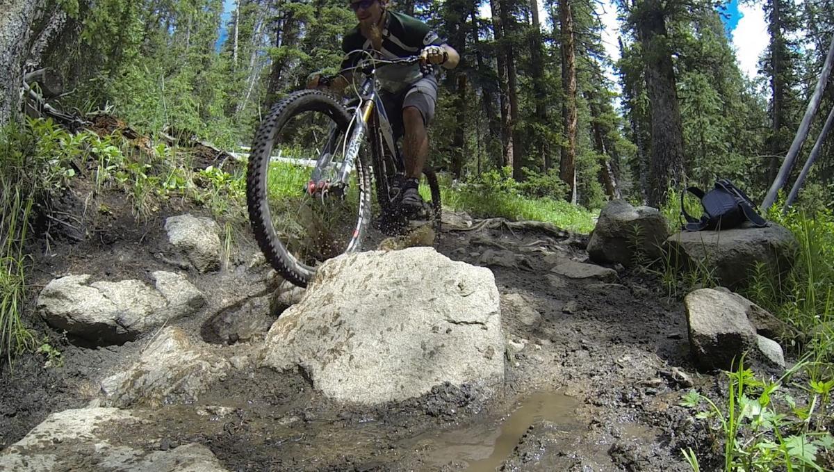 Big rocks, mud holes, moto ruts, and slick roots on the upper half of Canyon Creek.