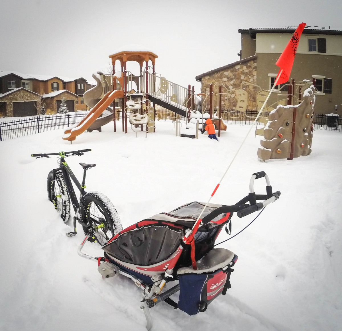 Riding around the neighborhood and taking your child to his or favorite playground is a great way to get them excited about fat biking in the snow with you
