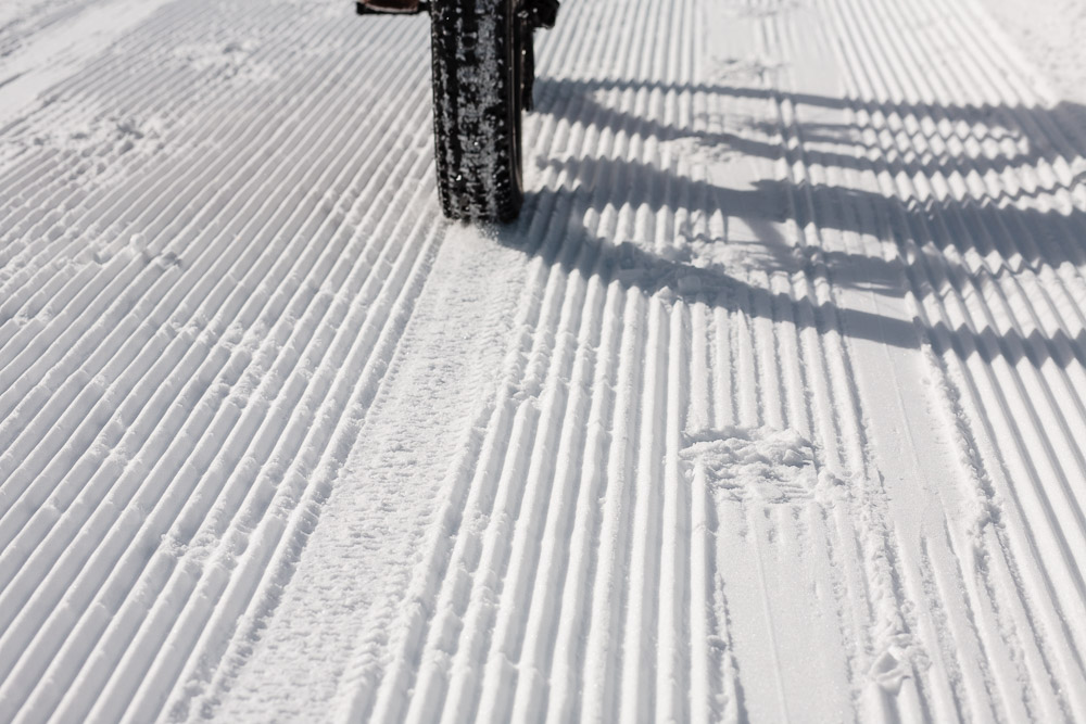 Fat bike tires barely crush the fresh corduroy on the Mineral Belt Trail