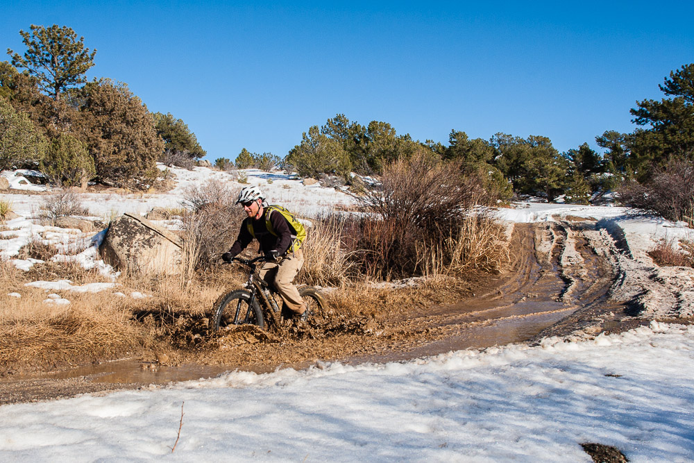 Brandon Slate rides through the slurry on FSR 375A in the Fourmile Travel Management Area