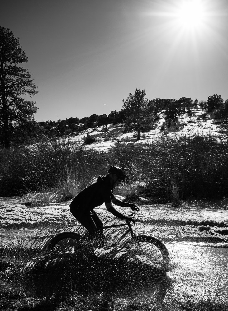 Ingrid Foutz takes on the mud puddles on FSR 375A in the Fourmile Travel Management Area