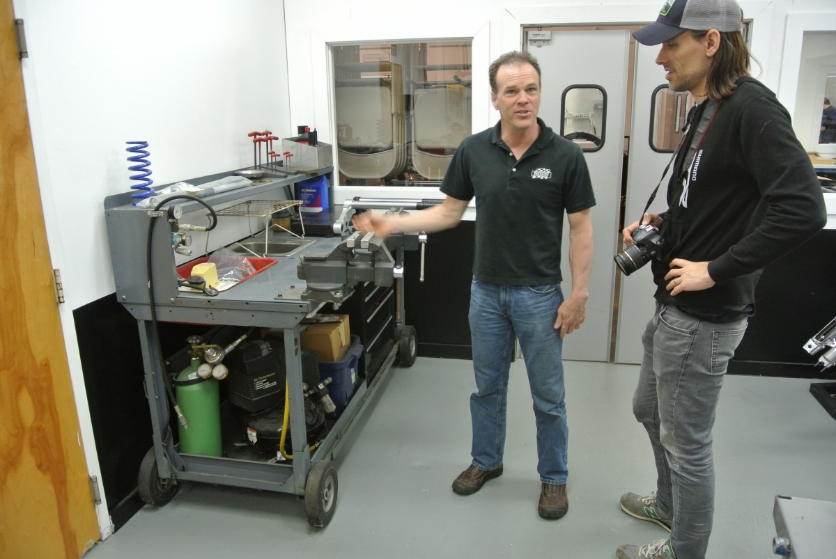 Max shows us his original shop, a cart he pushed around racetracks