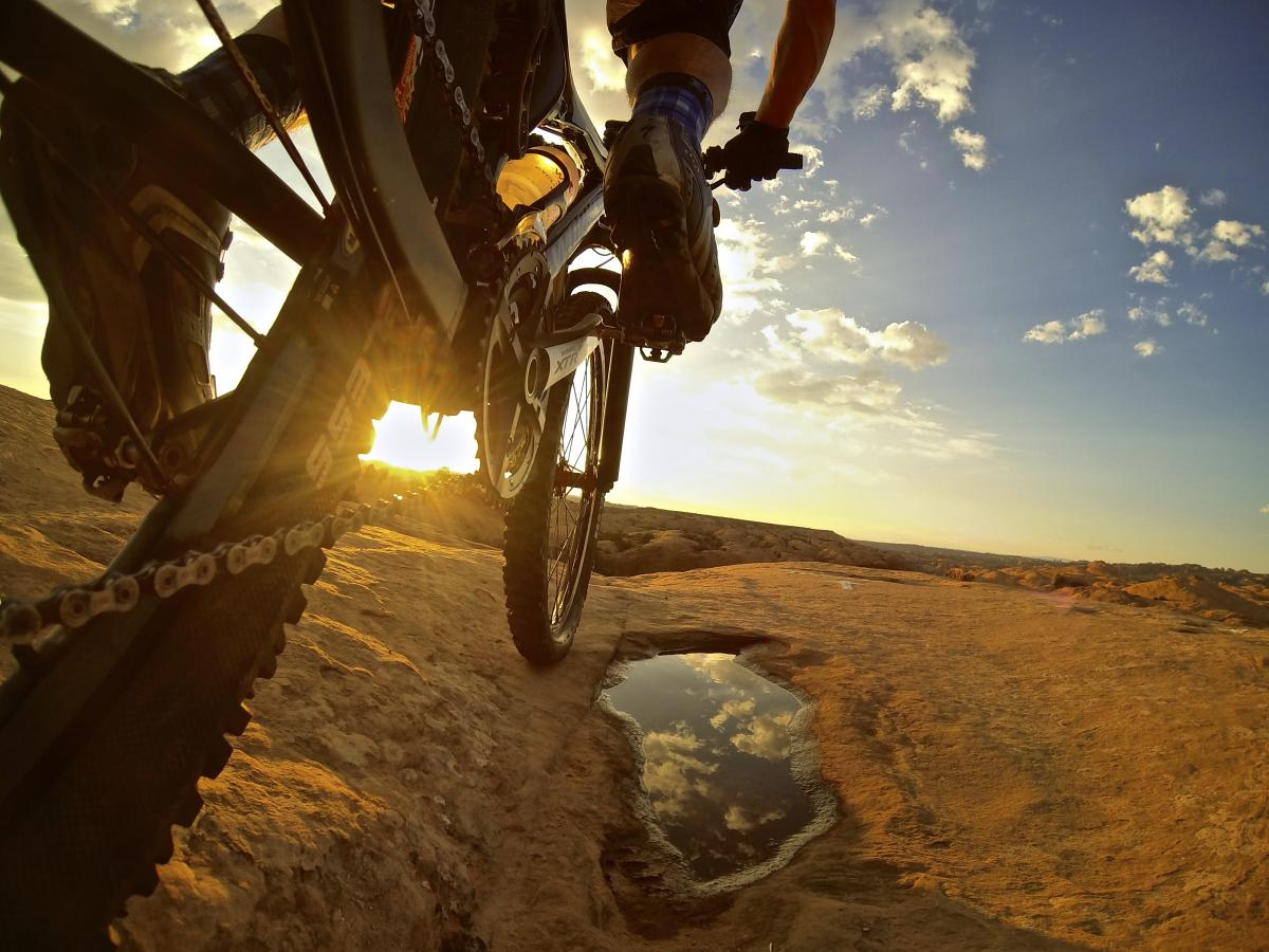 Sunset Slickrock ride with moments of reflection thanks to recent rain. photo: Erik Proano