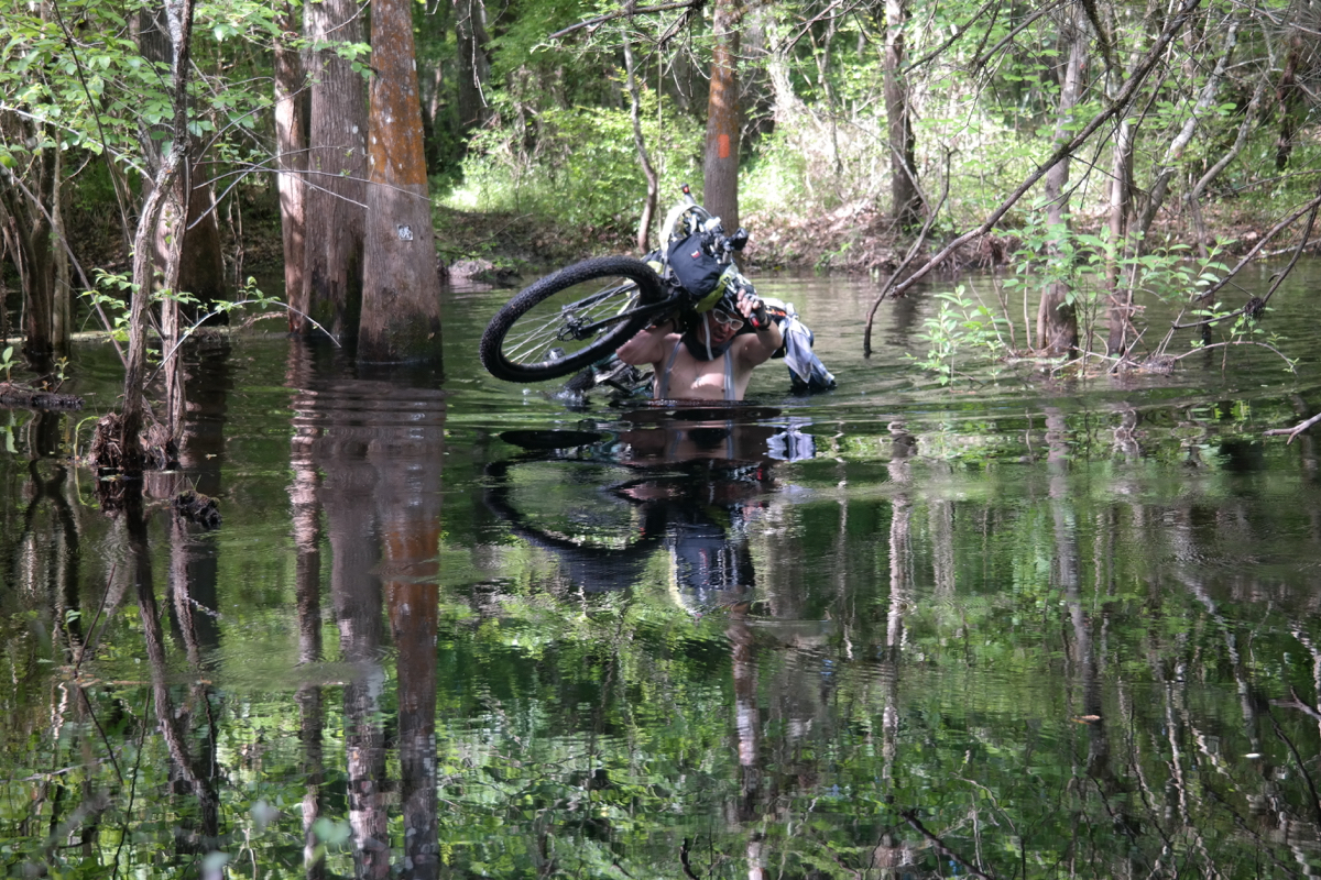 A flat tire is the least of your worries when there are alligators around - Photo courtesy of Singletrack Samurais Facebook page