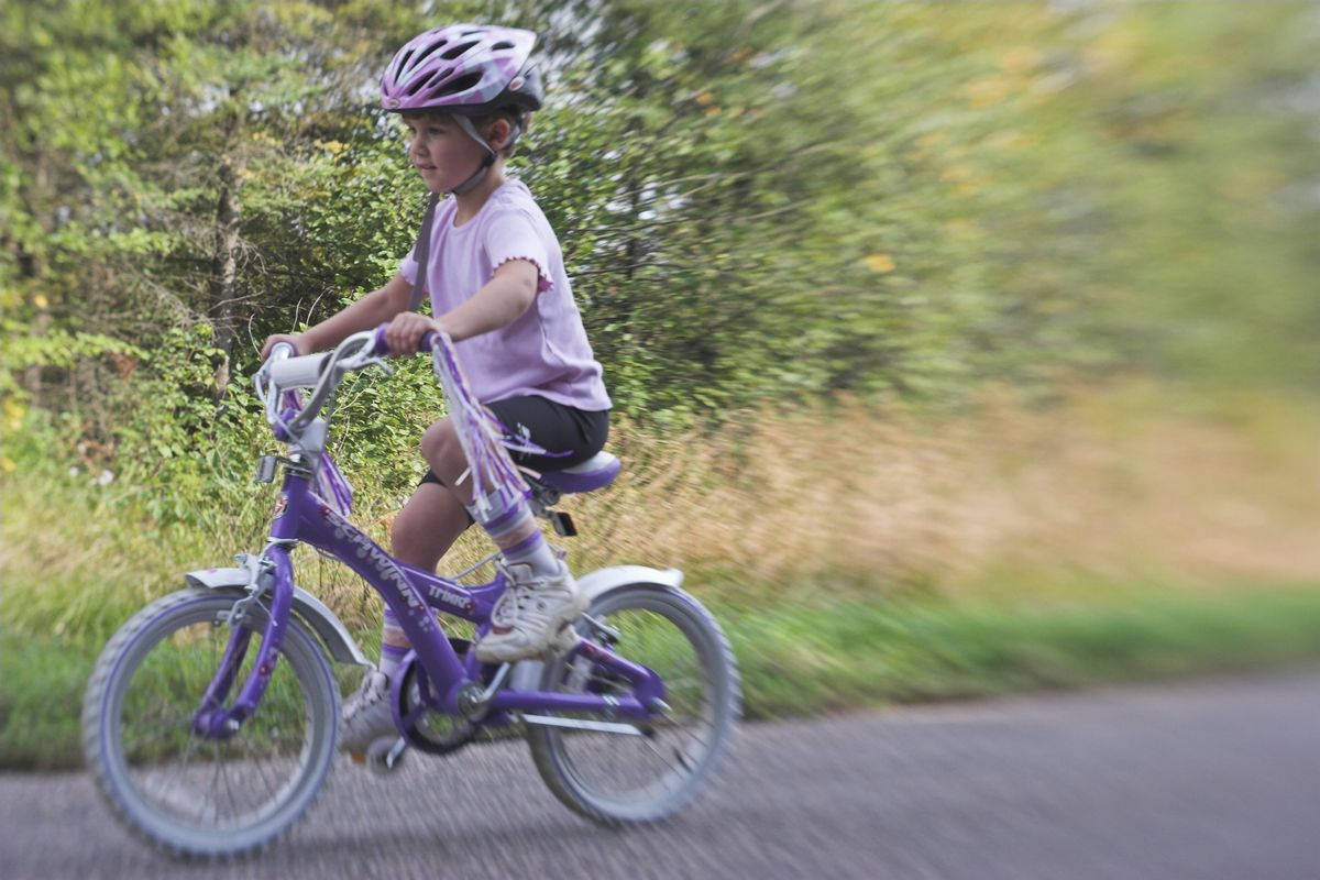 After stoking the tandem and riding the Piccolo, Emma had no problem transitioning to her own bike at age 5.