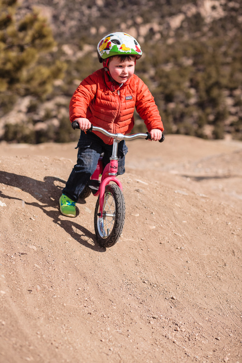 3 year old Wilder riding the Buena Vista pump track on a balance bike. All photos by Scott Anderson except where noted.