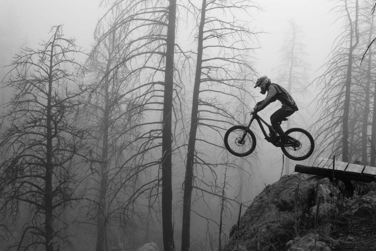 """Joshua Hildreth shredding the homemade trails in the fog at Donkey Hills bike park in Northern Colorado on his Devinci Wilson."" Photo: codyish"