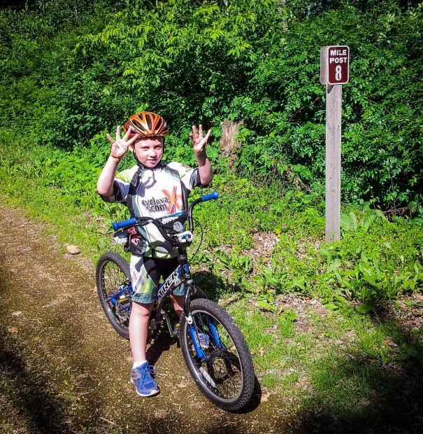 a child enjoys his first 8 mile ride on the gandy dancer trail