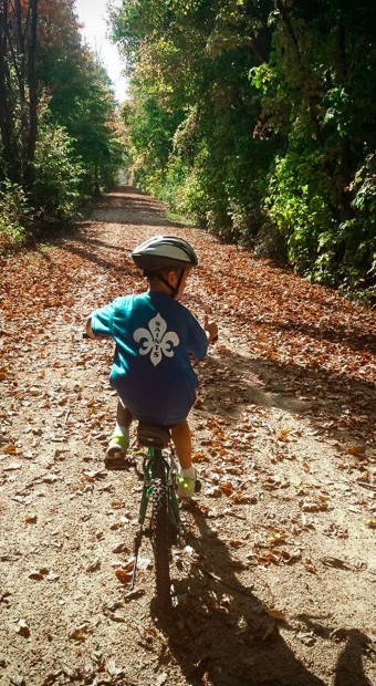 child on the gandy dancer trail in st. croix falls