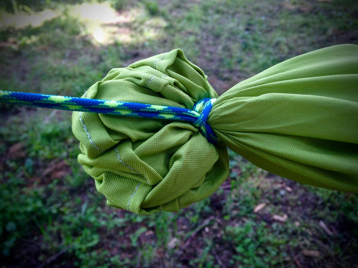 Using a lark's head knot, secure loops below gathered ends