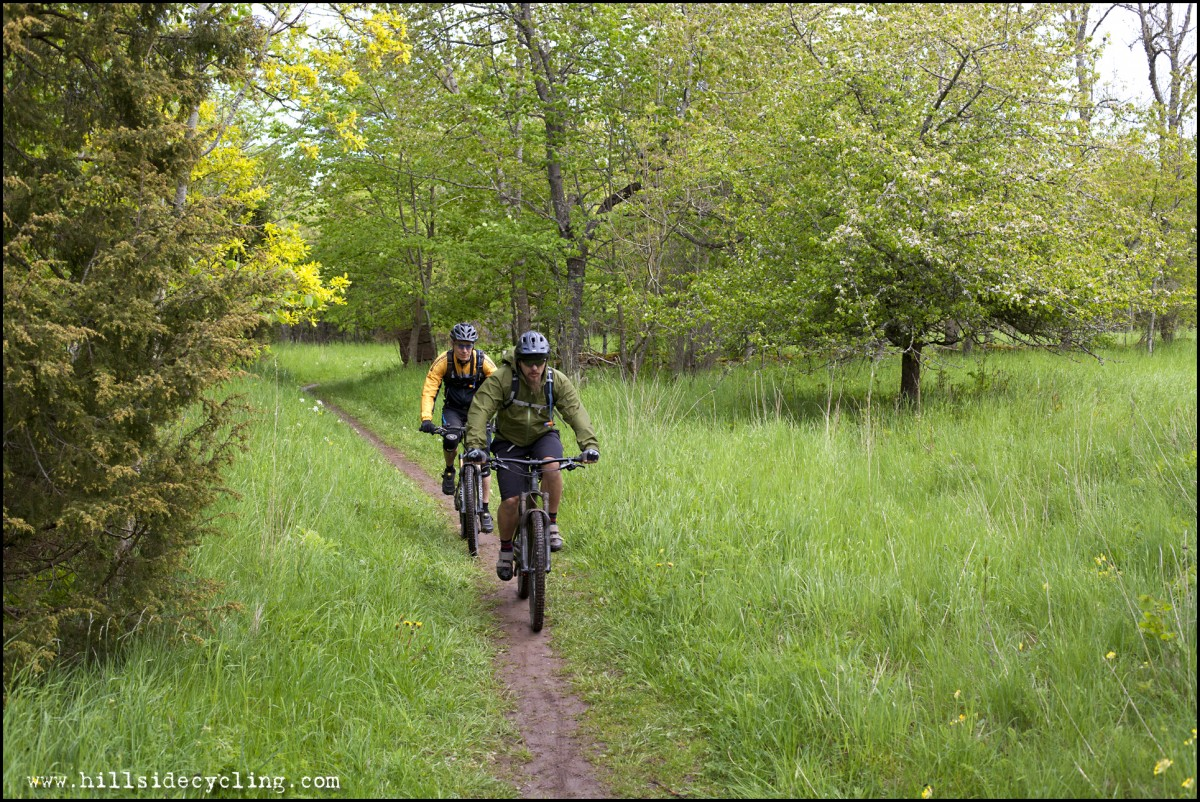 Pedalling singletrack through historic pastures. Riders: Greg Heil, Leo Ranta. Photo: Natasja Jovic.