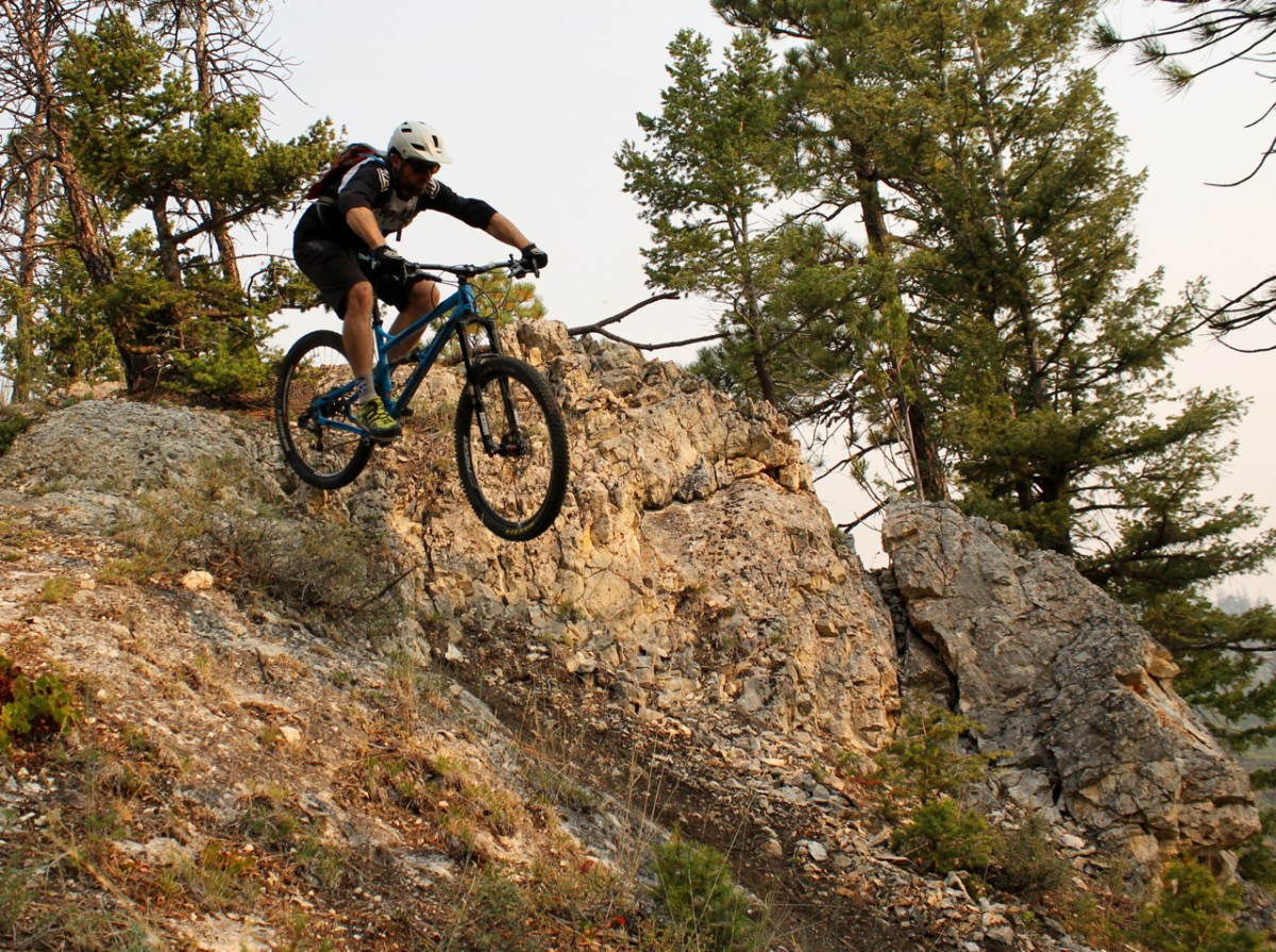 Drew Swayne launches a side hit on the Mount Helena Ridge Trail. Photo: Greg Heil