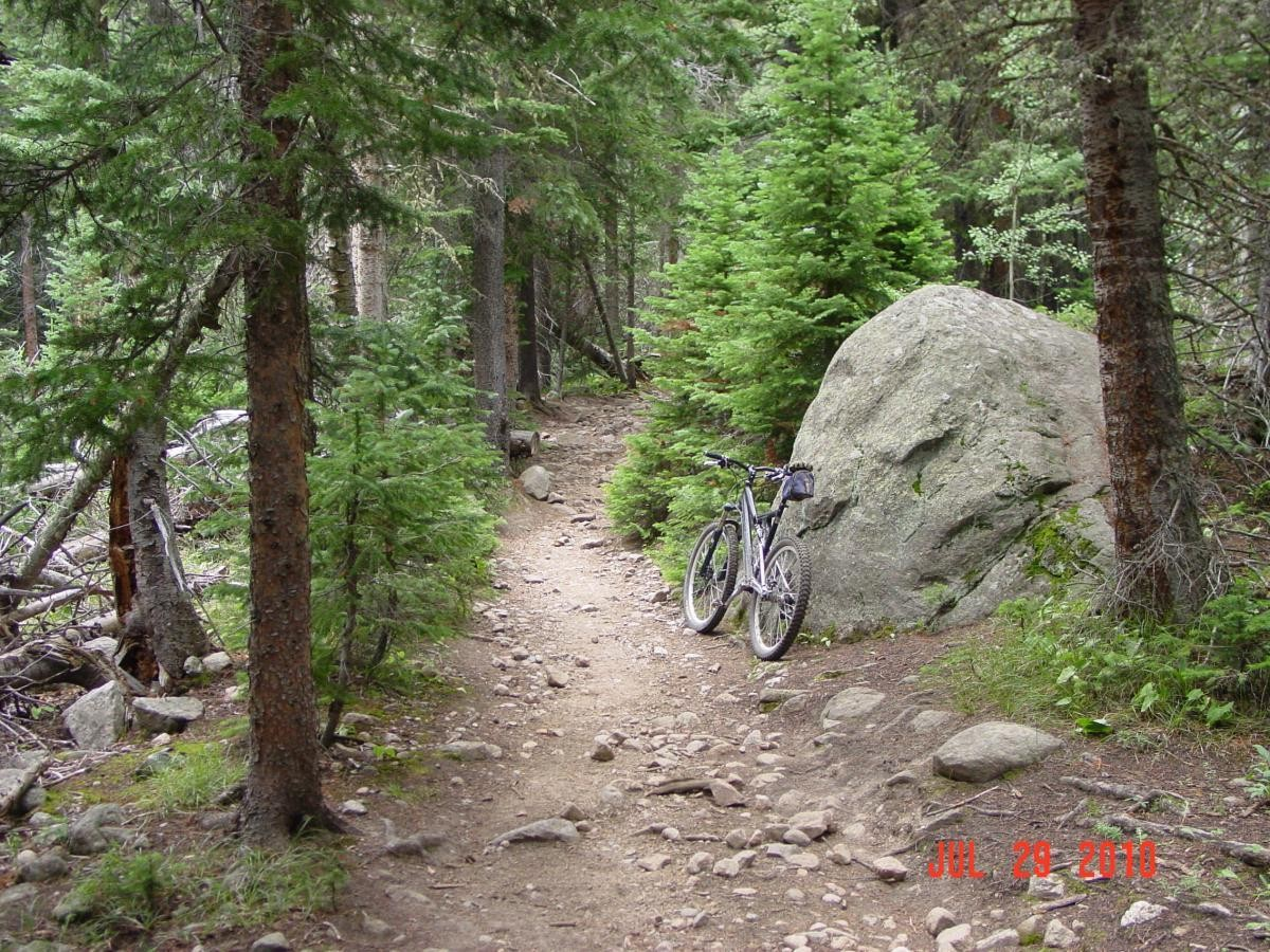 This is the gorgeous Buchanan Pass Trail in Colorado. In another mile, the trail crosses the Indian Creek Wilderness Boundary. The trail and surrounding environment are similar on both sides of the imaginary line, yet bikes must turn around.