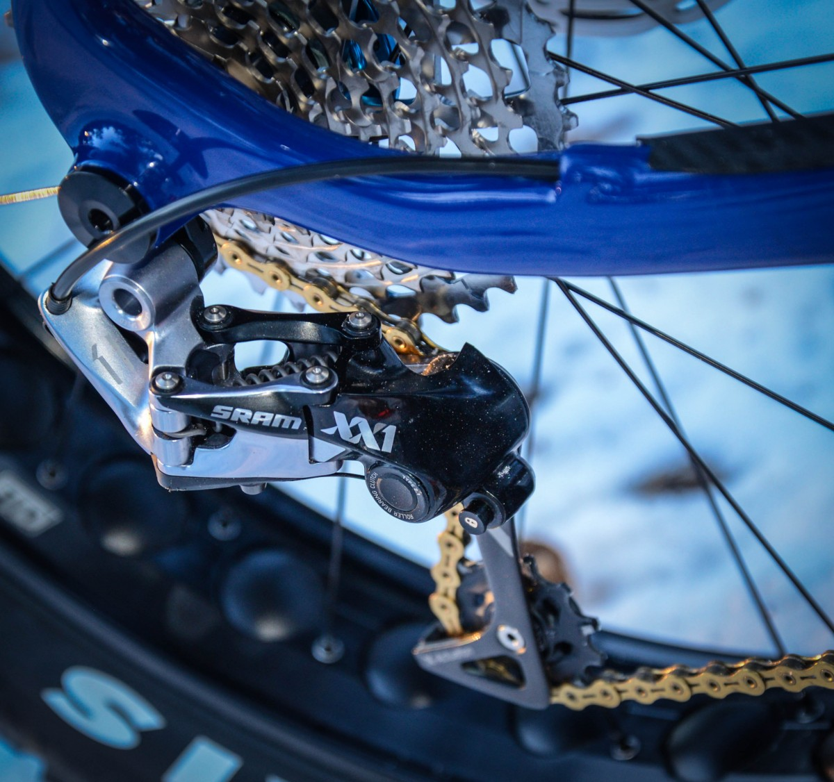 The SRAM XX1 rear derailleur mates perfectly with the KMC chain and makes a very good chainline to accommodate 5 inch tires