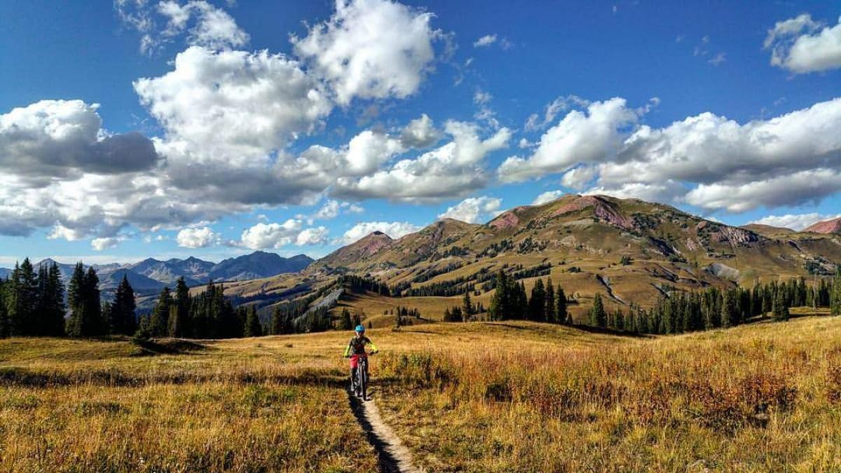 Riding the 401 Trail in Crested Butte, Colorado. Rider: Caren Villaroman. Photo: Dinno Domingo.