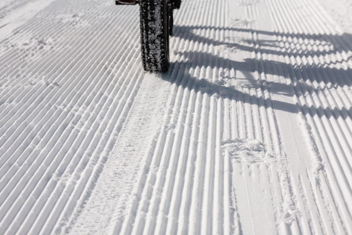 Fat tires barely crush the corduroy of fresh groomed ski trails