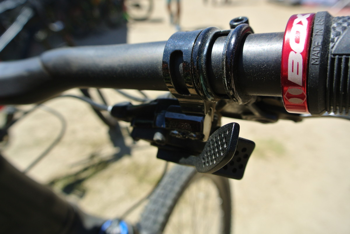 Push like a regular shifter for an easier gear, push in for a harder one
