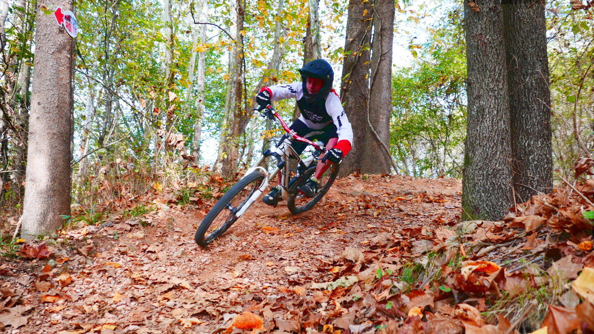 Banked turns are common in Bentonville. And fun. But don't let the full-face helmets full you … this are very XC oriented trails. It's just that these guys have bounced their faces off that sharp, hard Northwest Arkansas rock. And they're known to go really fast downhill.