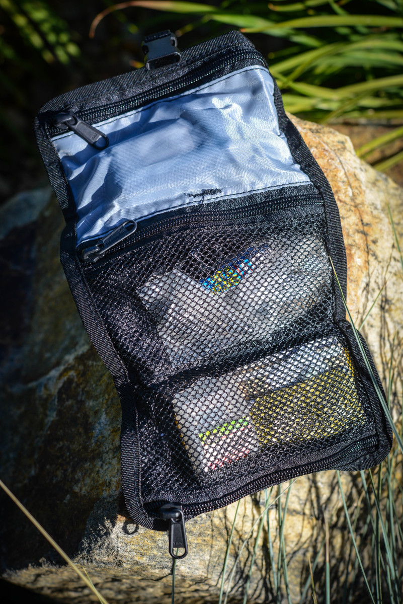 The tool pouch unrolled to reveal handy pockets to store tools and essential items