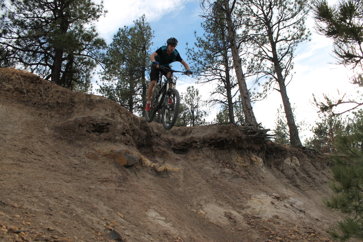 Junior launches one of the unofficial lines in Ute Valley Park.