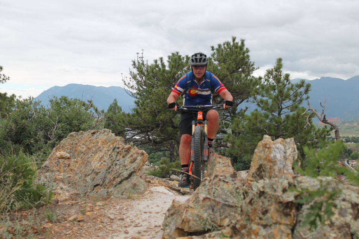 Cresting the new ridge trail at Ute Valley Park with Cheyenne Mountain in the background (photo: Lisa Fisch)