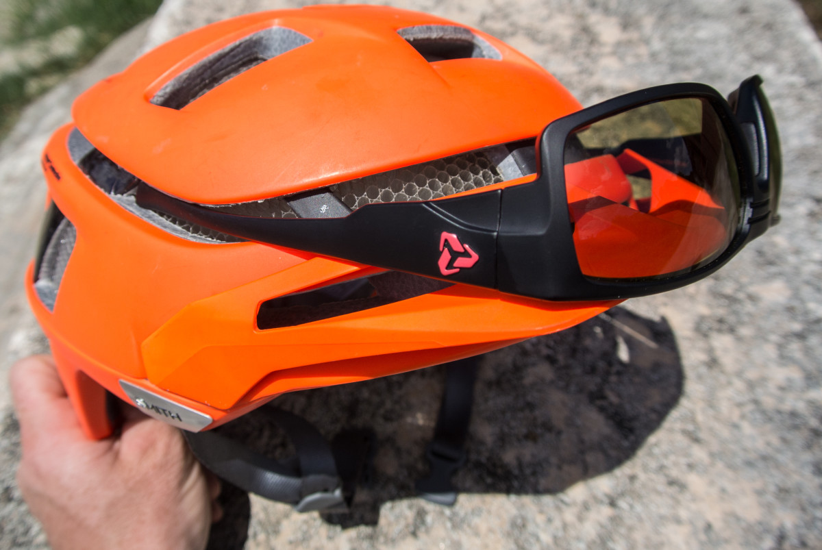 This handy groove on the helmet will hold some sporty type sunglasses