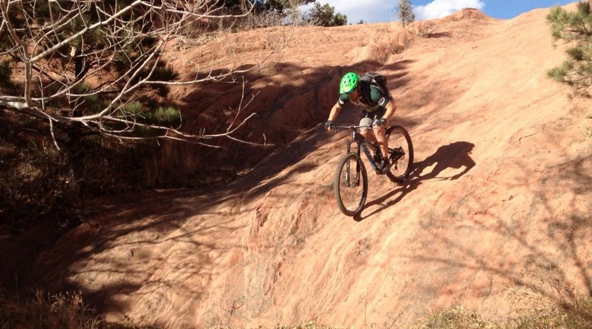 Singletracks editor Greg Heil rolls a beautiful sandstone slab at Red Rock Canyon Open Space.