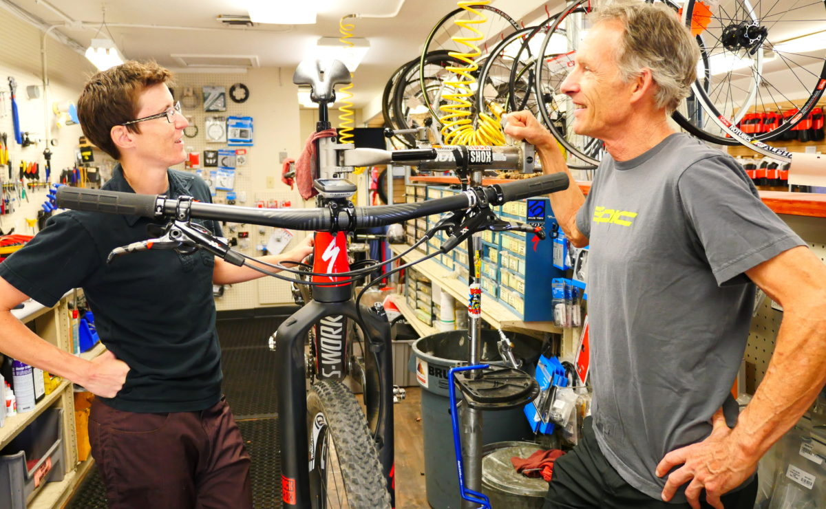 Ned talks over the condition of his favorite ride, a Specialized Epic, with Mountain Bike Specialists' mechanic, Darian.