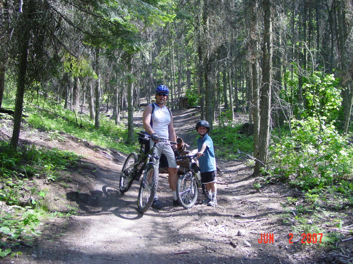 An early father son ride on Spencer Mountain, Whitefish MT (photo: Lisa Fisch)