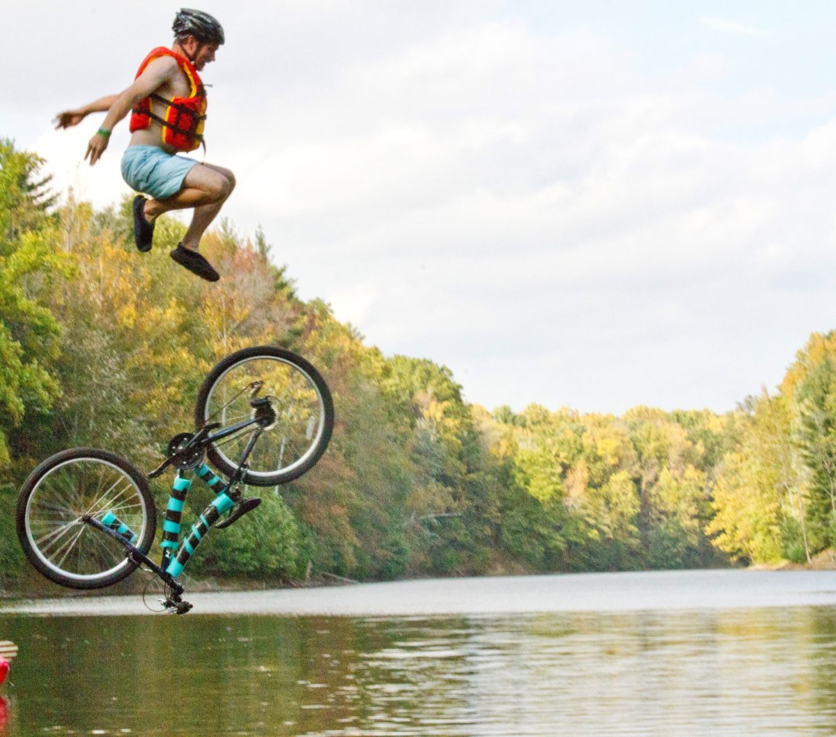 If you make it across the floating trail but had hoped for a little cooling off in the lake, grab a loaner bike and launch off the dock jump. Photo by: Andrea Wilson