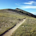 Pain of altitude and pleasure of scenery combine to form the Yin and Yang of the Monarch Crest trail (Singletracks photo by Maddslacker)