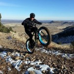 """Paul chillin' out (literally) on the long climb on Belcher trail at White Ranch Open Space today (12/23/12). The winds were gusting so strong it knocked us off the trail several times. The trails at the top were covered in a foot of snow...and we had a blast ripping downhill in it though."" Photo: Brandon Solari."