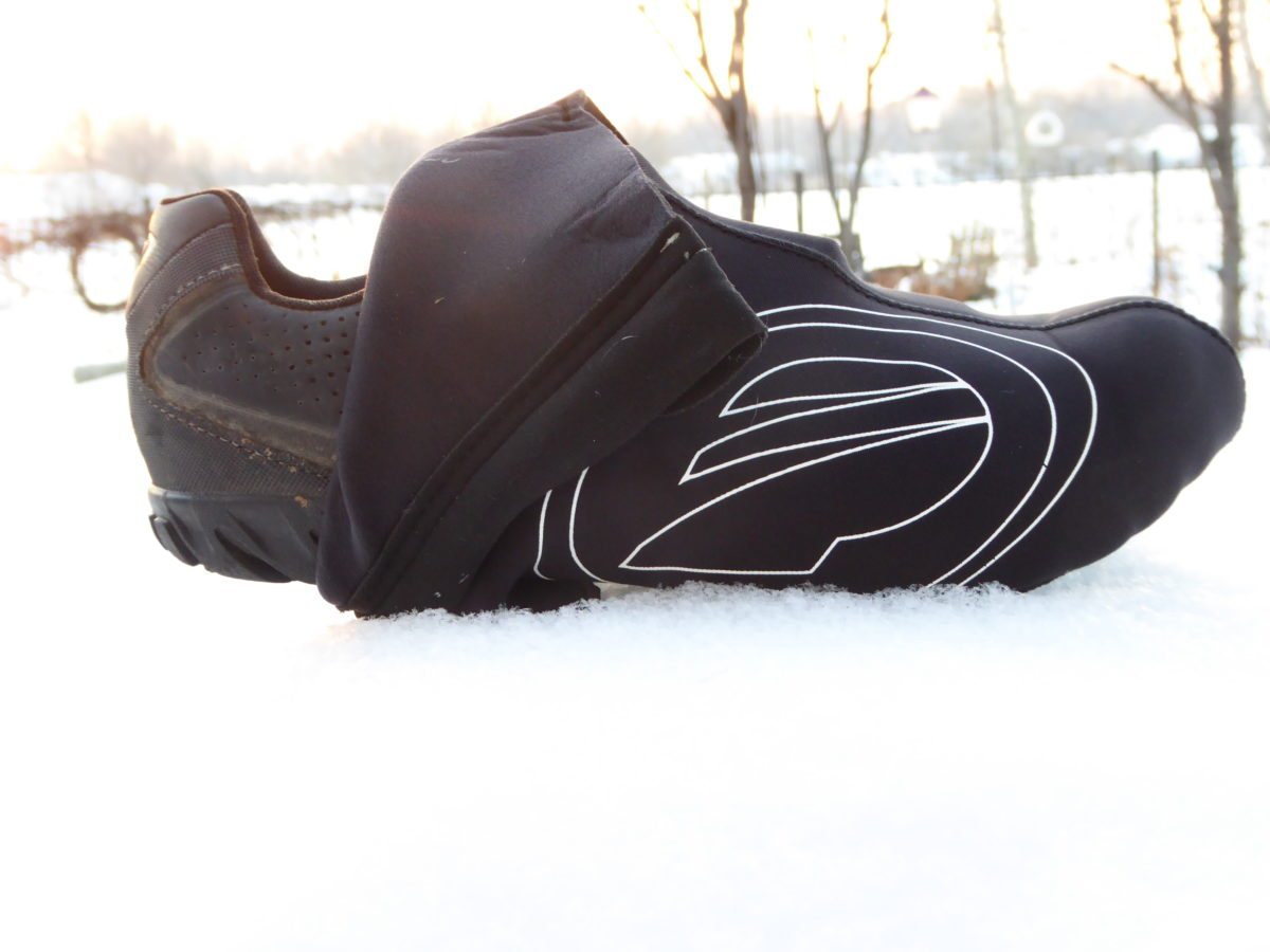 You don't need special shoes. Neoprene shoe covers are reasonably priced and will keep your toes toasty.