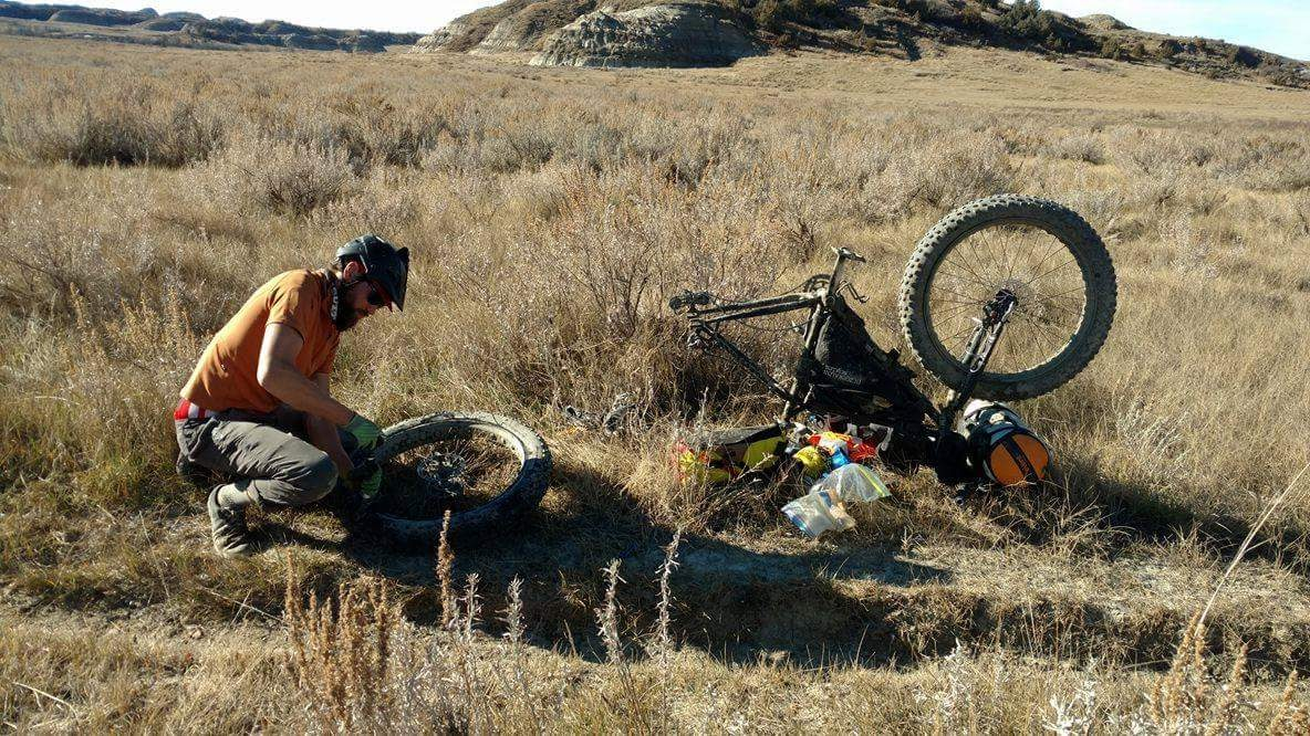 Flat tire on the fourth and final day of the Maah Daah Hey. I hit a sharp cow bone, rolling fast through open grasslands. Photo: Joe Stiller
