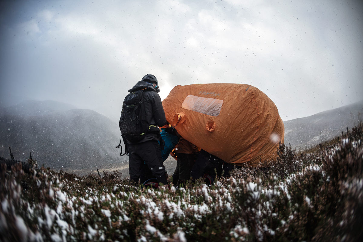 Ducking into a bothy bag to ride out a snow storm during one of my rides in Scotland. Photo: Ross Bell