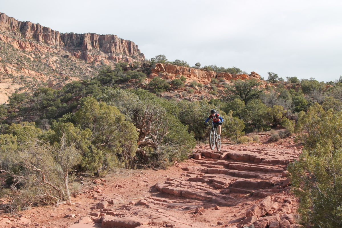 Who says an old jeep route can't be an awesome downhill romp? There are ledges and air opportunities galore on Moab's Flat Pass trail.