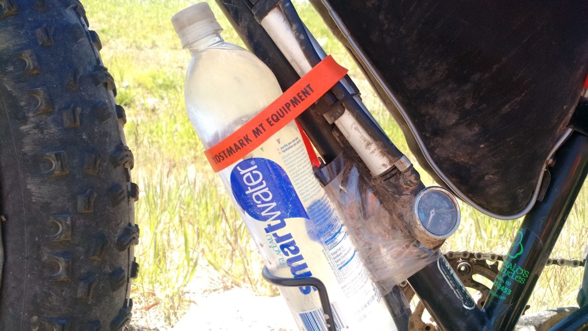 Voile straps securing water bottle.