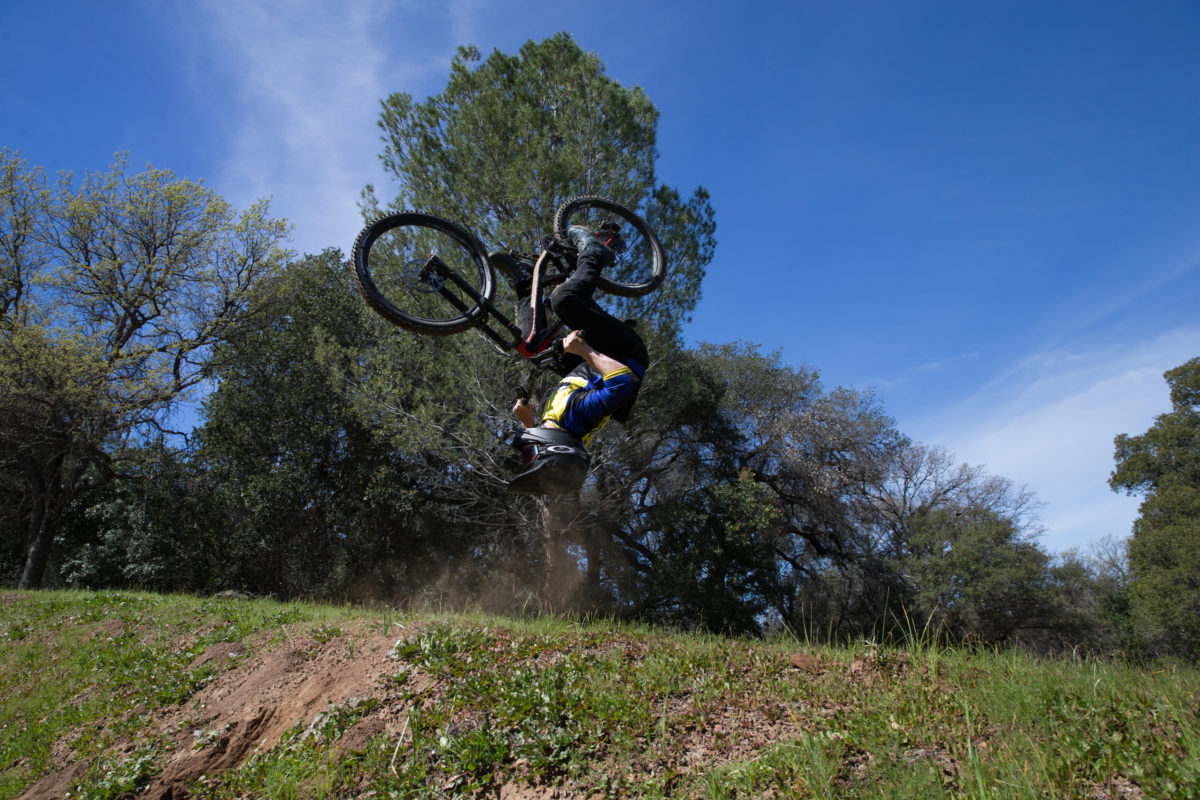 Gavin Godfrey can backflip seemingly anytime, anywhere. But if you were the first person in the world to throw a triple backflip on a mountain bike, that's kind of expected. Photo: Will Matthews.